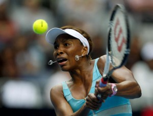 Williams of the U.S. hits a return to Sara Errani of Italy during their match at the Australian Open tennis tournament in Melbourne