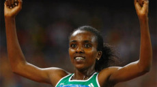 Dibaba of Ethiopia gestures after winning the women's 5000m final at the Beijing 2008 Olympic Games