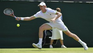 Kevin Anderson of South Africa hits a return to Tomas Berdych of the Czech Republic during their men's singles tennis match at the Wimbledon Tennis Championships, in London