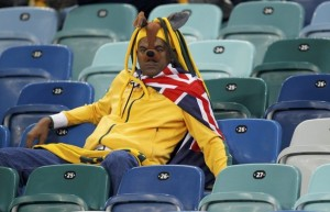 An Australia fan watches the 2010 World Cup Group D soccer match against Germany at Moses Mabhida stadium in Durban
