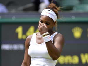 Serena Williams of the U.S. reacts during her women's singles tennis match against Sabine Lisicki of Germany at the Wimbledon Tennis Championships, in London
