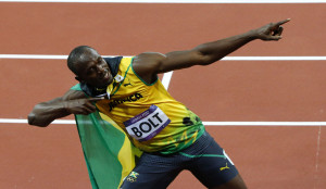 Jamaica's Usain Bolt celebrates after winning the men's 100m final during the London 2012 Olympic Games at the Olympic Stadium
