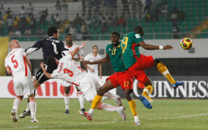 Stephane Mbia of Cameroon gets his shot away to score during their quarter-final match against Tunisia at the African Nations Cup soccer tournament in Tamale