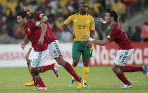 Morocco's Mehdi Namli celebrates his goal with team mates during their African Nations Cup Group A match against South Africa at the Moses Mabhida stadium in Durban
