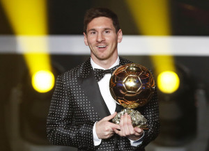 Messi of Argentina FIFA World Player of the Year 2012 holds his FIFA Ballon d'Or trophy during the FIFA Ballon d'Or 2012 soccer awards ceremony in Zurich