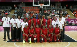 Members of Angola's national team pose before their women's Group A basketball match against Turkey at the London 2012 Olympic Games in the Basketball arena