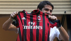 Brazilian player Kaka holds up an AC Milan jersey after arriving in Milan