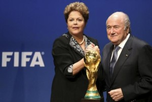 Brazil's President Rousseff poses with FIFA President Blatter after delivering a statement at the FIFA headquarters in Zurich