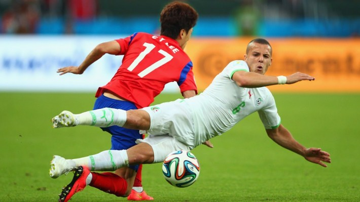 Djamel-Mesbah-of-Algeria-competes-for-the-ball-with-Lee-Chung-Yong-of-South-Korea