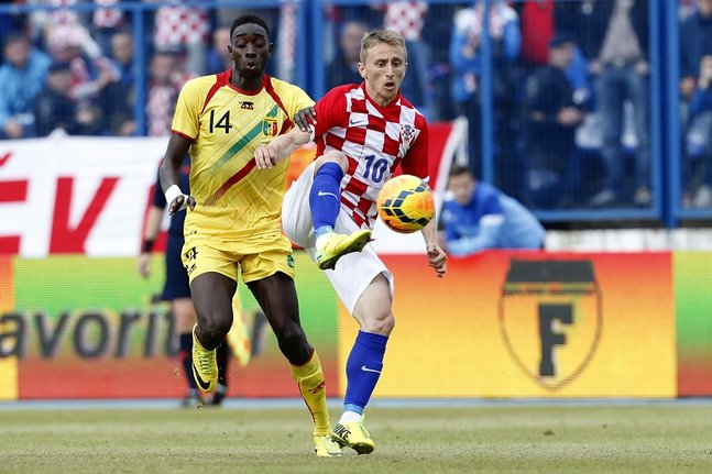 Modric of Croatia fights for the ball with Yattabare of Mali during their international friendly soccer match in Osijek