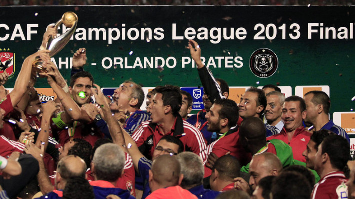 Egypt's Al Ahli players celebrate with the trophy after winning their African Champions League final soccer match against South Africa's Orlando Pirates in Cairo