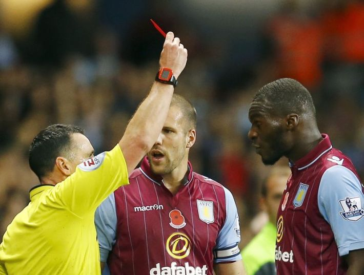Referee Neil Swarbrick shows Aston Villa's Christian Benteke the red card during their English Premier League soccer match against Tottenham Hotspur at Villa Park in Birmingham