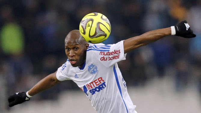 Olympique Marseille's Fanni heads the ball during their French Ligue 1 soccer match against Stade de Reims at the Velodrome stadium in Marseille