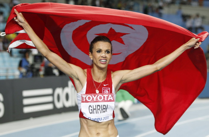 Ghribi celebrates placing second in the women's 3,000 metres steeplechase final at the IAAF World Athletics Championships in Daegu