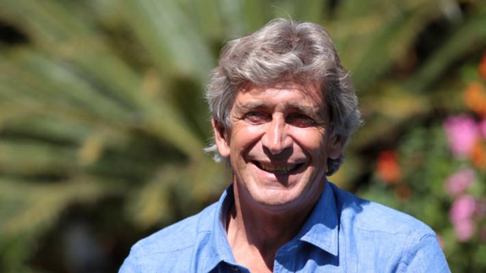 Main Manuel holding image