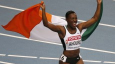 Murielle Ahoure of the Ivory Coast celebrates winning second place in the women's 100 metres final during the IAAF World Athletics Championships at the Luzhniki Stadium in Moscow August 12, 2013.  REUTERS/Maxim Shemetov (RUSSIA  - Tags: SPORT ATHLETICS)