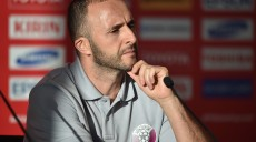 Coach of Qatar Djamel Belmadi listens to a question at a press conference for the AFC Asian Cup in Sydney on January 14, 2015. AFP PHOTO/Peter PARKS --IMAGE RESTRICTED TO EDITORIAL USE - STRICTLY NO COMMERCIAL USE