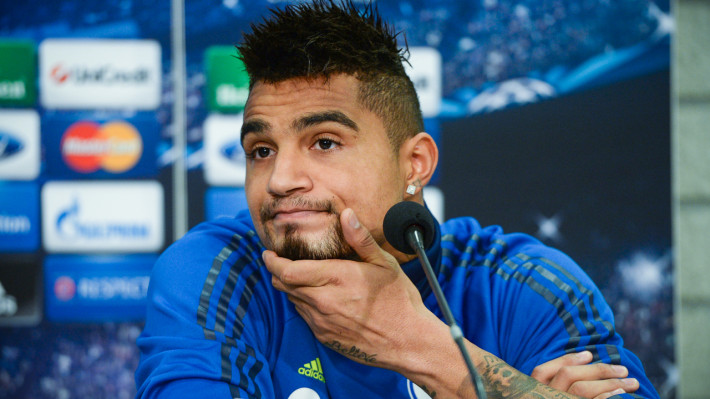 Schalke's midfielder Kevin Prince Boateng listens to journalists' questions during a press conference in Gelsenkirchen western Germany on December 10, 2013, on the eve of the UEFA Champions League football match FC Schalke against FC Basel. AFP PHOTO / PATRIK STOLLARZ        (Photo credit should read PATRIK STOLLARZ/AFP/Getty Images)