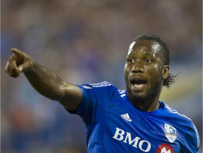 MONTREAL, QUE.: AUGUST 22, 2015 -- Didier Drogba points to a sideline official in his debut for the Montreal Impact against the Philadelphia Union in M.L.S. action at Saputo Stadium in Montreal Saturday, August 22, 2015.  (John Kenney / MONTREAL GAZETTE)