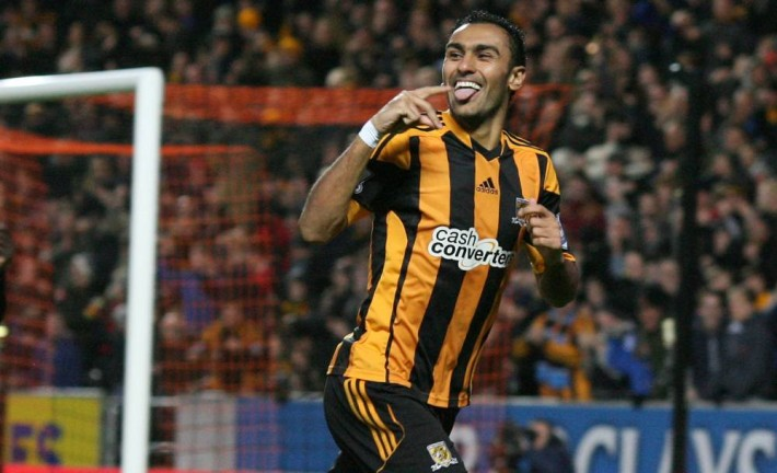 Hull City's Egyptian midfielder Ahmed Elmohamady celebrates scoring the opening goal of the English Premier League football match between Hull City and Fulham at the KC Stadium in Hull on December 28, 2013.  AFP PHOTO / LINDSEY PARNABY RESTRICTED TO EDITORIAL USE. No use with unauthorized audio, video, data, fixture lists, club/league logos or live services. Online in-match use limited to 45 images, no video emulation. No use in betting, games or single club/league/player publications.LINDSEY PARNABY/AFP/Getty Images