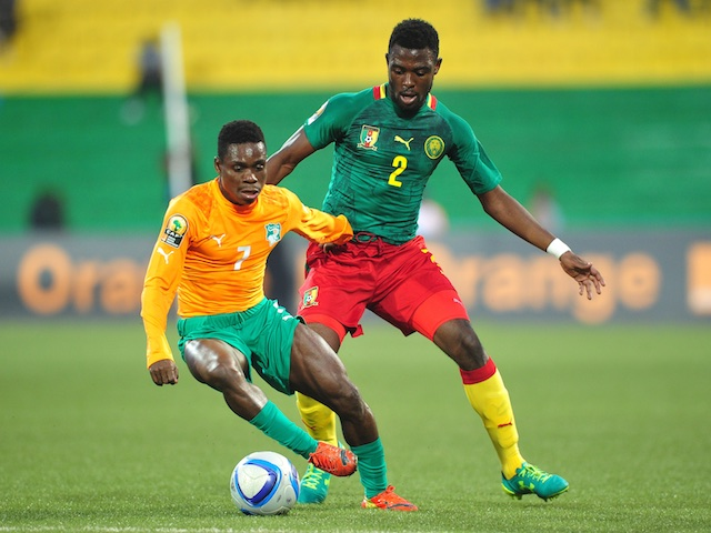 Djobo Atcho of Ivory Coast controls the ball as he is challenged by Joseph Ngwem of Cameroon during the 2016 CHAN Rwanda quarterfinal between Cameroon and Ivory Coast at Huye Stadium, Butare on 30 January 2016 ©Ryan Wilkisky/BackpagePix