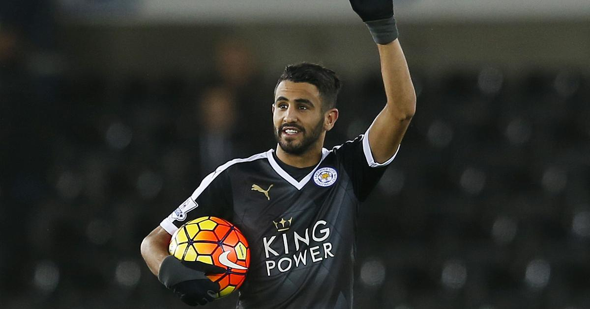 """Football Soccer - Swansea City v Leicester City - Barclays Premier League - Liberty Stadium - 5/12/15 Leicester City's Riyad Mahrez celebrates with the match ball after the game after scoring a hat trick Action Images via Reuters / Paul Childs Livepic EDITORIAL USE ONLY. No use with unauthorized audio, video, data, fixture lists, club/league logos or """"live"""" services. Online in-match use limited to 45 images, no video emulation. No use in betting, games or single club/league/player publications.  Please contact your account representative for further details. - RTX1XC0L"""