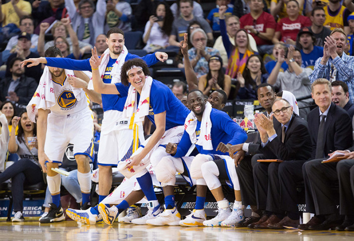 Mar 16, 2016; Oakland, CA, USA; Golden State Warriors bench celebrate in the final minutes of the game against the New York Knicks during the fourth quarter at Oracle Arena. The Warriors defeated the Knicks 121-85. Mandatory Credit: Kelley L Cox-USA TODAY Sports