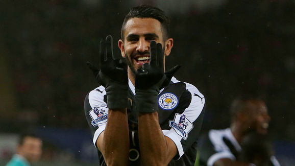 Leicester City's Algerian midfielder Riyad Mahrez celebrates after scoring his third goal during the English Premier League football match between Swansea City and Leicester City at The Liberty Stadium in Swansea, south Wales on December 5, 2015.       AFP PHOTO / GEOFF CADDICK  RESTRICTED TO EDITORIAL USE. No use with unauthorized audio, video, data, fixture lists, club/league logos or 'live' services. Online in-match use limited to 75 images, no video emulation. No use in betting, games or single club/league/player publications. / AFP / GEOFF CADDICK        (Photo credit should read GEOFF CADDICK/AFP/Getty Images)
