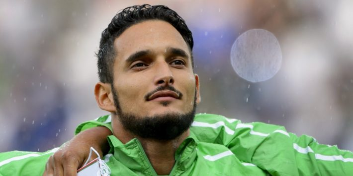 Algeria's defender Liassine Cadamuro listens the national anthem prior to a friendly football match between Algeria and Romania on June 4, 2014, in Geneva, ahead of the upcoming FIFA World Cup 2014 in Brazil. Algeria won 2-1.  AFP PHOTO / FABRICE COFFRINI        (Photo credit should read FABRICE COFFRINI/AFP/Getty Images)