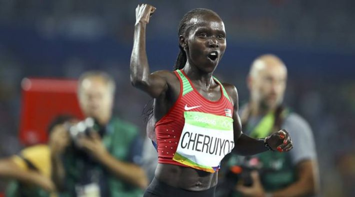 2016 Rio Olympics - Athletics - Final - Women's 5000m Final - Olympic Stadium - Rio de Janeiro, Brazil - 19/08/2016. Vivian Cheruiyot (KEN) of Kenya celebrates winning the gold. REUTERS/Lucy Nicholson FOR EDITORIAL USE ONLY. NOT FOR SALE FOR MARKETING OR ADVERTISING CAMPAIGNS.
