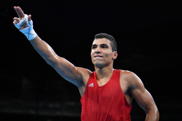 Morocco's Mohammed Rabii celebrates winning against Ireland's Steven Gerard Donnelly during the Men's Welter (69kg) Quarterfinal 1 at the Rio 2016 Olympic Games at the Riocentro - Pavilion 6 in Rio de Janeiro on August 13, 2016.   / AFP PHOTO / Yuri CORTEZ