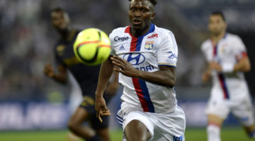 Lyon's French defender Mapou Yanga-Mbiwa runs with the ball during the French L1 football match between Olympique Lyonnais (OL) and Association sportive de Monaco (ASM) on May 7, 2016 at the Parc de l'Olympique Lyonnais in Decines-Charpieu, central eastern France.  / AFP PHOTO / ROMAIN LAFABREGUE