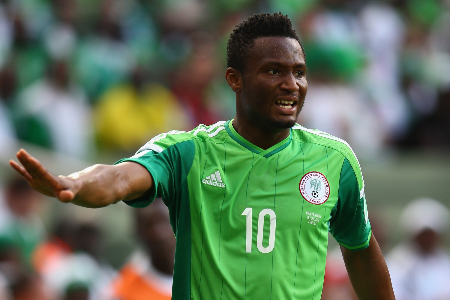 CURITIBA, BRAZIL - JUNE 16: John Obi Mikel of Nigeria gestures during the 2014 FIFA World Cup Brazil Group F match between Iran and Nigeria at Arena da Baixada on June 16, 2014 in Curitiba, Brazil.  (Photo by Julian Finney/Getty Images)