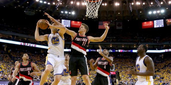 OAKLAND, CA - APRIL 19: Zaza Pachulia #27 of the Golden State Warriors goes up for a shot against Meyers Leonard #11 of the Portland Trail Blazers Game Two of the Western Conference Quarterfinals during the 2017 NBA Playoffs at ORACLE Arena on April 19, 2017 in Oakland, California. NOTE TO USER: User expressly acknowledges and agrees that, by downloading and or using this photograph, User is consenting to the terms and conditions of the Getty Images License Agreement.   Ezra Shaw/Getty Images/AFP