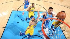 OKLAHOMA CITY, OK - APRIL 3: Russell Westbrook #0 of the Oklahoma City Thunder drives to the basket against JaVale McGee #1 of the Golden State Warriors during the game on April 3, 2018 at Chesapeake Energy Arena in Oklahoma City, Oklahoma. NOTE TO USER: User expressly acknowledges and agrees that, by downloading and or using this photograph, User is consenting to the terms and conditions of the Getty Images License Agreement. Mandatory Copyright Notice: Copyright 2018 NBAE (Photo by Joe Murphy/NBAE via Getty Images)