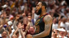CLEVELAND, OH - MAY 25: LeBron James of the Cleveland Cavaliers reacts after a basket in the fourth quarter against the Boston Celtics during Game Six of the 2018 NBA Eastern Conference Finals at Quicken Loans Arena on May 25, 2018 in Cleveland, Ohio. NOTE TO USER: User expressly acknowledges and agrees that, by downloading and or using this photograph, User is consenting to the terms and conditions of the Getty Images License Agreement.   Gregory Shamus/Getty Images/AFP