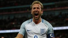 England's striker Harry Kane celebrates scoring the opening goal during the FIFA World Cup 2018 qualification football match between England and Slovenia at Wembley Stadium in London on October 5, 2017.  / AFP PHOTO / Adrian DENNIS / NOT FOR MARKETING OR ADVERTISING USE / RESTRICTED TO EDITORIAL USE