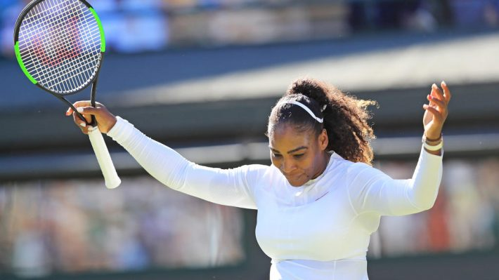 Serena Williams of United States is vexed at losing a point during the ladies' singles first round of the Wimbledon tennis tournament against Arantxa Rus of Netherlands at All England Tennis Club in London on July 2, 2018.  ( The Yomiuri Shimbun )