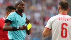 Samara (Russian Federation), 17/06/2018.- Referee Malang Diedhiou of Senegal shows a yellow card to Branislav Ivanovic (R) of Serbia during the FIFA World Cup 2018 group E preliminary round soccer match between Costa Rica and Serbia in Samara, Russia, 17 June 2018.  (RESTRICTIONS APPLY: Editorial Use Only, not used in association with any commercial entity - Images must not be used in any form of alert service or push service of any kind including via mobile alert services, downloads to mobile devices or MMS messaging - Images must appear as still images and must not emulate match action video footage - No alteration is made to, and no text or image is superimposed over, any published image which: (a) intentionally obscures or removes a sponsor identification image; or (b) adds or overlays the commercial identification of any third party which is not officially associated with the FIFA World Cup) (Mundial de Fútbol, Rusia) EFE/EPA/TATYANA ZENKOVICH EDITORIAL USE ONLY